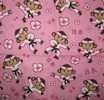 Karate Monkeys on Pink Fabric