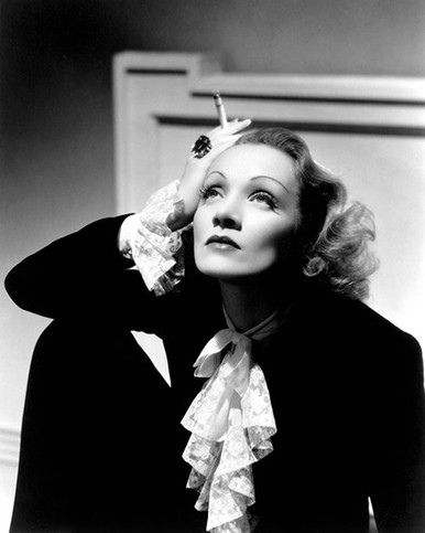 Marlene Dietrich holding a cigarette Premium Photograph and Poster