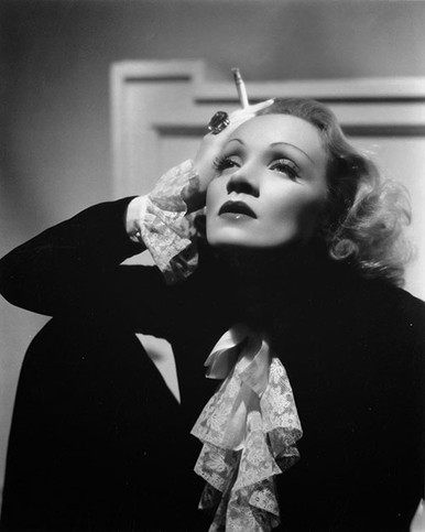 Marlene Dietrich striking pose holding a cigarette Premium Photograph and Poster