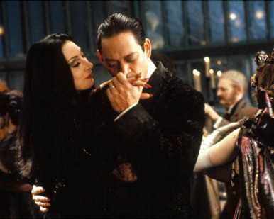 Anjelica Huston & Raul Julia in The Addams Family (1991) Poster and Photo