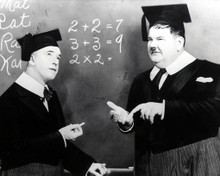 Stan Laurel & Oliver Hardy in A Chump At Oxford (Laurel & Hardy) Poster and Photo