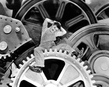 Charles Chaplin in Modern Times a.k.a. les temps modernes Poster and Photo