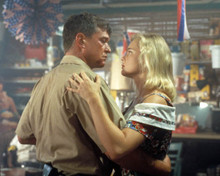 Erika Eleniak & Tom Berenger in Chasers Poster and Photo