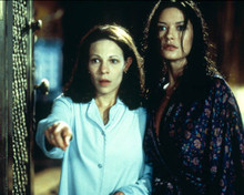 Lili Taylor & Catherine Zeta Jones in The Haunting Poster and Photo