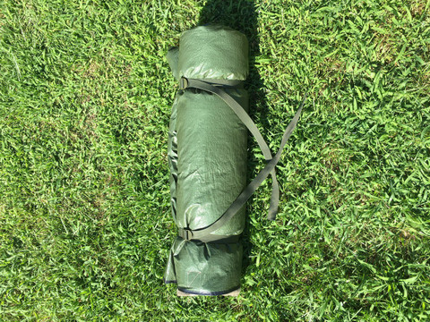 The Backwoods Blanket rolls up into a convenient bedroll configuration