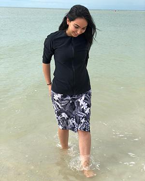 model-wearing-style-2622-black-floral-walking-in-ocean-s-.jpg