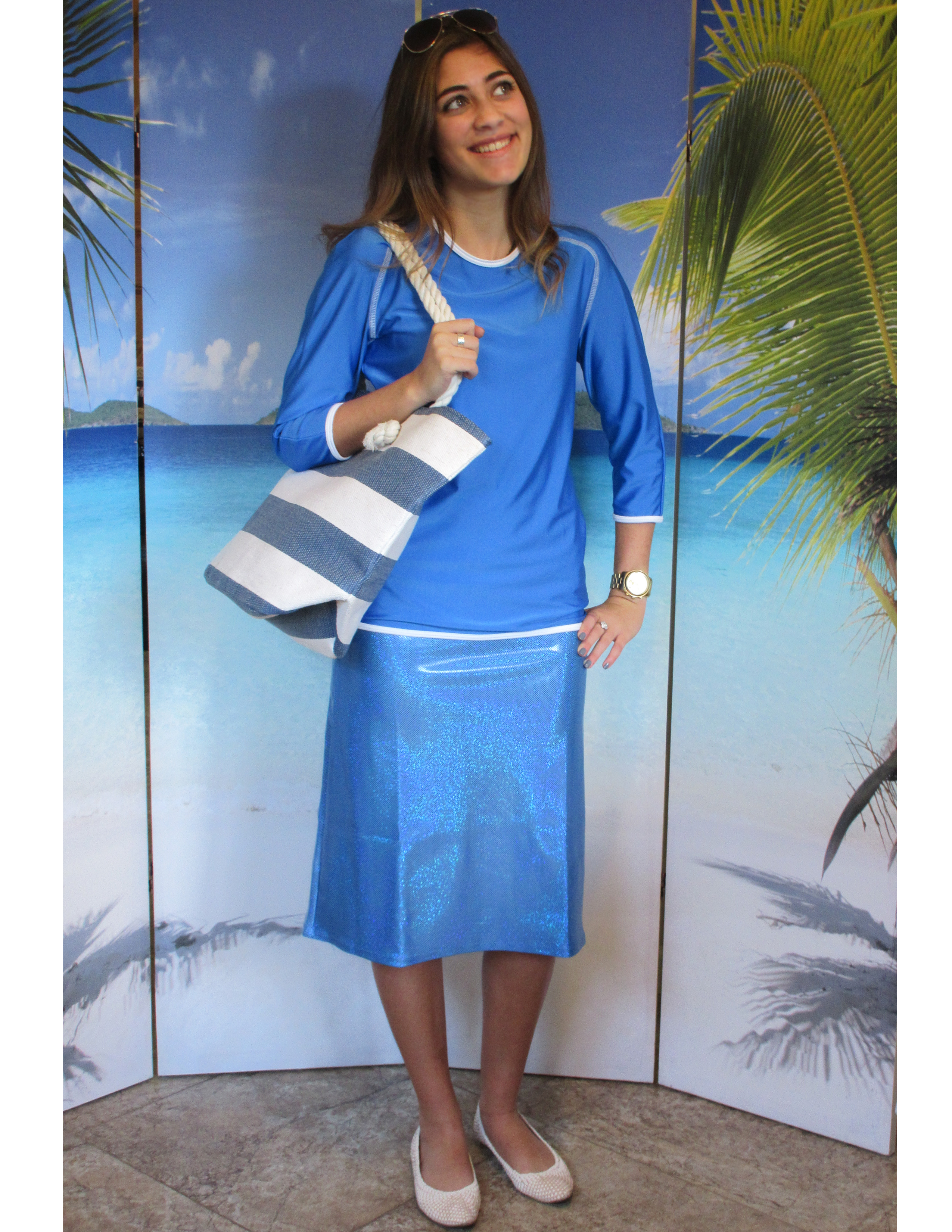 model-wearing-style-2629-in-sailing-blue-with-sparkle-blue-skirt-and-beach-bag.jpg