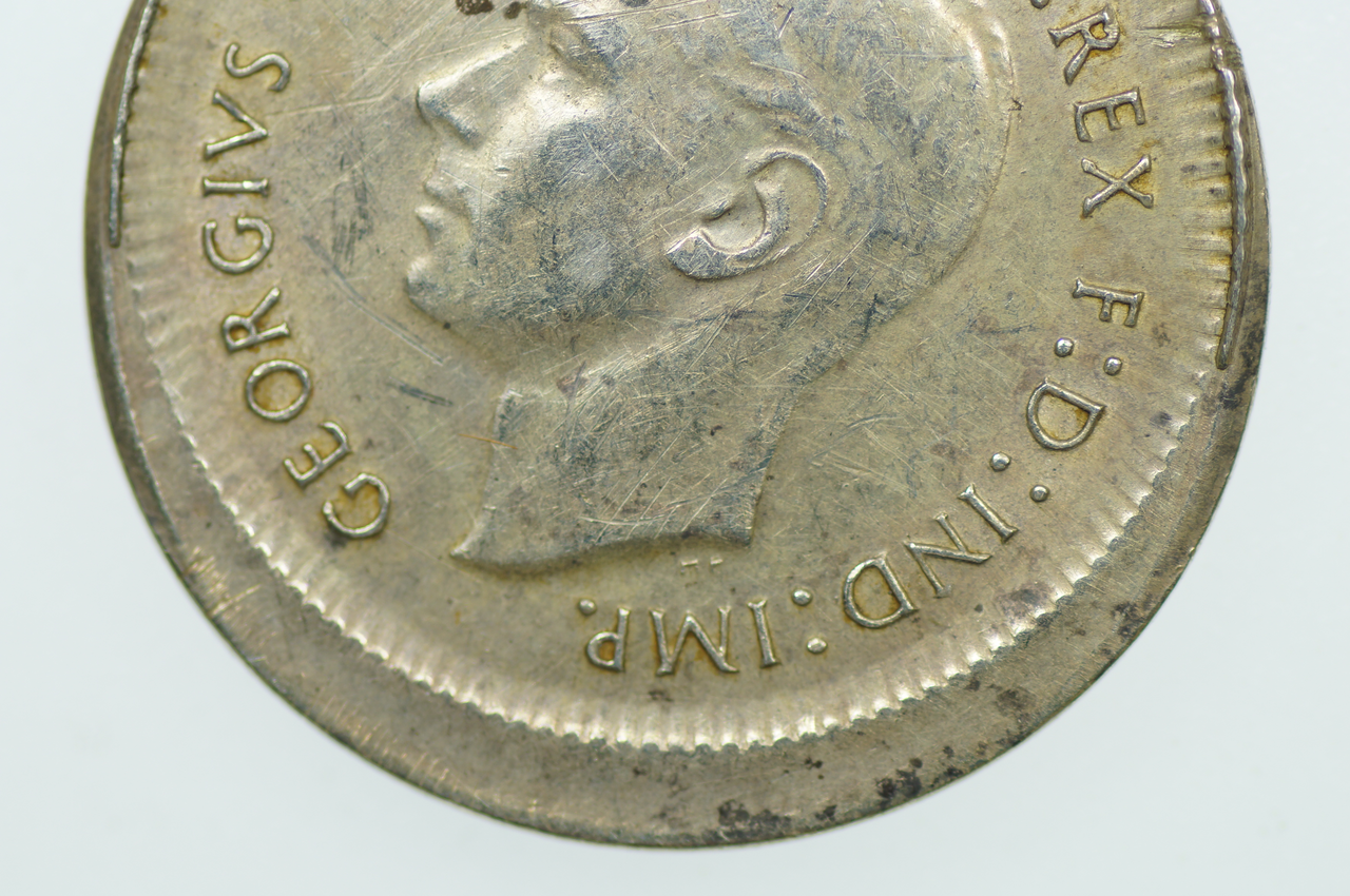 Australian 1945 Sixpence Variety Error Mis-Strike George VI in Very Fine Condition Obverse Close Up