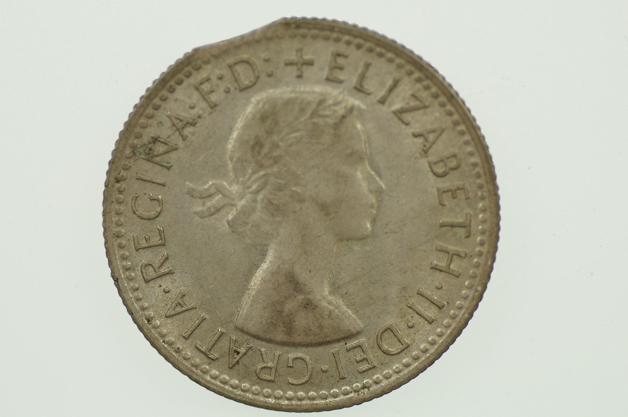 1957 Shilling Variety Error Bitten Edge Elizabeth II in Very Fine Condition Obverse
