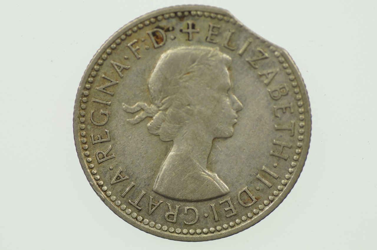 1958 Shilling Variety Error Bitten Edge Elizabeth II in Very Fine Condition Obverse
