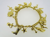 18ct Yellow Gold 19 cm 16 Charm Bracelet 31.1 Grams