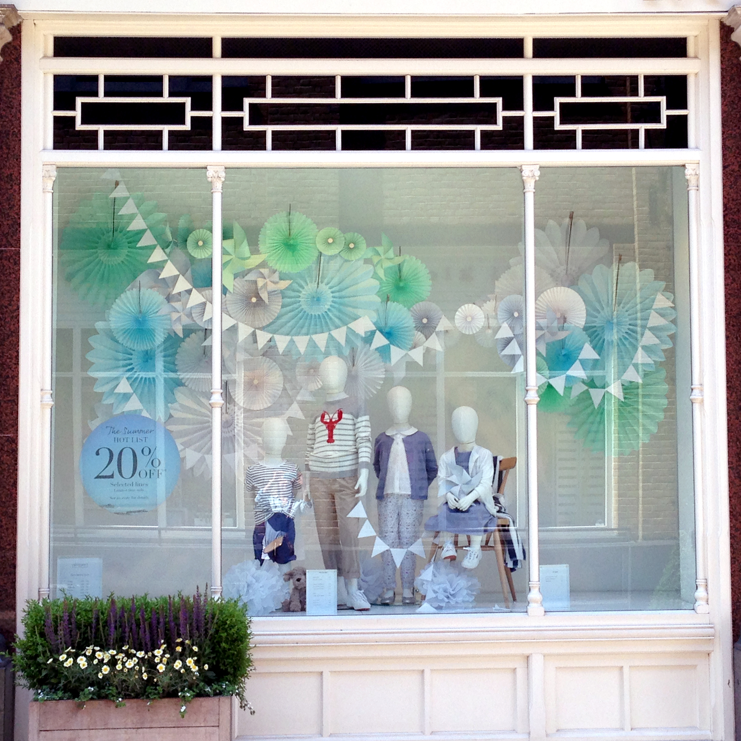 paper-bunting-and-fan-decorations-in-retail-window-display.jpg