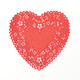Red heart lace paper doilies for hen parties, craft projects and wedding decorations.