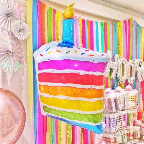 Birthday cake party balloon for rainbow themed birthdays or baking parties