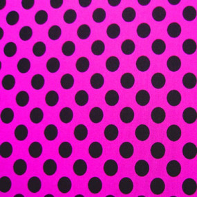 Hot pink fabric with black polka dots