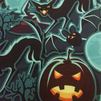 Halloween themed fabric featuring jack-o-lanterns, black cats, bats and full moons.