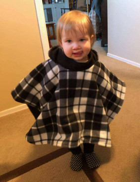 Toddler Poncho shown in black and white plaid.