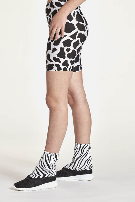 Gaiters for hikers and trail runners shown in black and white zebra. side view.