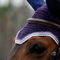 Upperville style shown in a blackberry base, with lilac mist and snow trims, and two strands of matching beads.