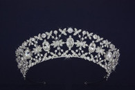 This is a 1 1/2 inch in height tiara with 7 quarter inch czech rhinestones and 7 half inch Swarovski crystals.