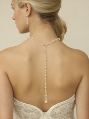 "Mariell's dramatic top-selling gold ""back"" necklace brings Red Carpet glamour to wedding & prom gowns with Ivory pearls & Iridescent crystals cascading down the back. Our neck is adj. 15 1/2"" to  17"" (plus the 7 1/2"" tail with a bold 12mm pearl at the end."