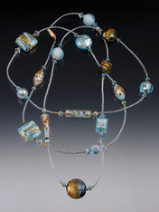 "A Venetian sky filled with soft clouds is yours to wrap around your neck as often as you like with this spectacular rope featuring 24K flecked celestial blue Venetian glass, 24K  Swarovski crystals, and 14K clasp. No two alike! All components custom-designed and imported from Italy! Choose 44"" or 64"