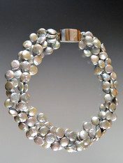 This luminous silver silk hand-knotted coin pearl torsade fatures a one-of-a-kind inlaid multi-toned shell clasp that can be worn as a side or center highlight.  20""