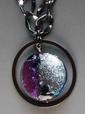 Dichroic disc blue, purple closeup