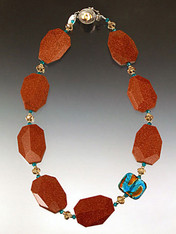 """One of our bestsellers!  Wearable all year round with faceted goldstone slices, swarovski crystals, and a custom Venetian glass aqua 24K highlight station. 18"""""""