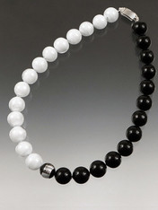 "Year round elegance and simplicity. This gleaming collar features bright white and bright black Venetian glass with a sterling silver ""window"" center.  18"""