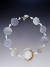 "A medley of Gray and White agate and white jade centered with a large agate disc.  18""  Last one!"