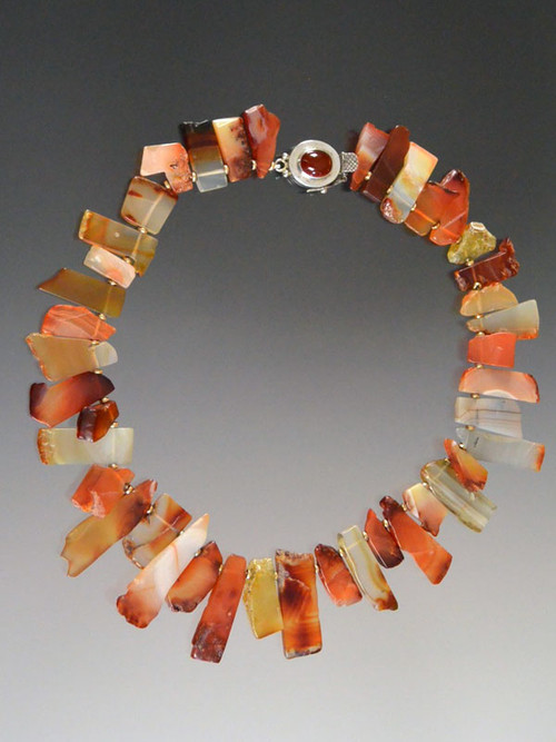 """Beautiful shards of carnelian in every shade spaced with 14K rondels and a garnet sterling clasp make a beautiful asymmetrical collar for any occasion and any outfit. 18"""""""