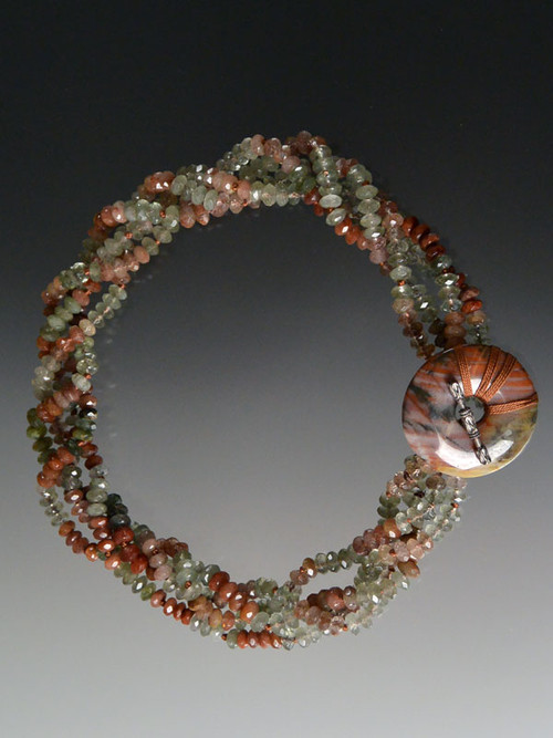 """It is extraordinarily rare to find naturally occurring yellow and black opal in the same strain.  Years ago I bought this strand of amazing two toned opal in large faceted nuggets. This season I made a super dramatic necklace with smaller yellow opal rondels mixed in and a large onyx sterling clasp. 20"""""""