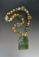 Fabulous hand-carved Chinese natural green jade pendant necklace features a green jade pendant with natural pale green and brown highlights,opal, jasper, and vintage bakelite.