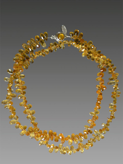"""These faceted citrine briolettes are from my collection of many years ago. You won't find them now at an affordable price if at all. Perfect for this season's mix and match mood this delicate rope features mandarin orange citrine briolettes.  Wear it long and layered or doubled or tripled.  32"""""""