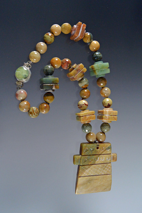 Fabulous green jade pendant necklace featuring faceted opal, jasper, and vintage bakelite.