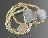 """Many years ago I bought a stash of solid sterling silver hexagon shaped beads.  This year I finally decided to pair them with one of a kind delicate silver lined duzy centerbeads.  Only four in equally subtle colors-dark champagne, light champagne, pale blue, and white.  7.5""""-8"""""""
