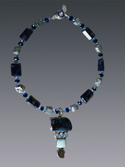 "A truly spectacular statement piece, this dramatic necklace features step cut high quality iolite (from the sapphire family) spaced with pyrite nuggets and a large vintage iolite druzy blue topaz, miniature ammonite pendant.  18"" Pendant 3"""