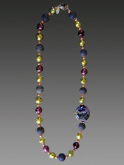 About 10 years ago a friend  on a trip to Venice brought me several extraordinary richly patterned Venetian beads in a a shape I've never seen again. This particular one of a kind bead features splashes of blue, ruby and olive and is the highlight of a shorter version of my purple druzy Venetian amethyst olive copper rope with a garnet clasp. 30""