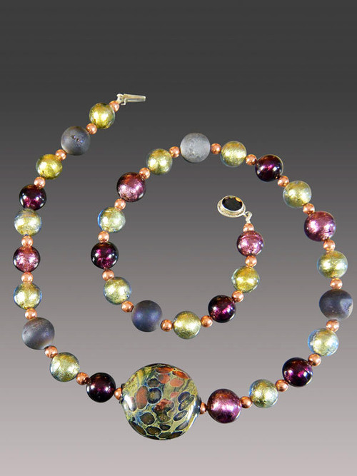 About 10 years ago a friend  on a trip to Venice brought me several extraordinary richly patterned Venetian beads in a a shape I've never seen again. This particular one of a kind bead features splashes of rich copper and is the highlight of a shorter version of my purple druzy Venetian amethyst olive copper rope with a garnet clasp..  Absolutely gorgeous and only one!