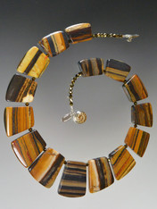 """If you favor earth tones and interesting patterns, this versatile tiger iron jasper fitted geometric collar spaced with tiny complementary Swarovski crystals will go with everything in your wardrobe all year round. 18"""""""