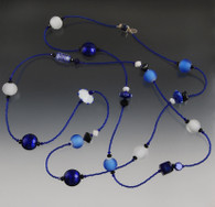 A  combination of white gold filled Venetian glass, one of a kind lampworked glass wheels and Swarovski crystals.