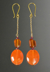 The height of luxury at an incredibly affordable price, these magnificent mandarin garnet dangle earrings are all you need to dress up and go out on the town. They feature deep orange mandarin garnet faceted ovals, freeform golden-wine faceted squares framed with wine garnet bicones suspended on a 14K chain with 18K earwires. 2""
