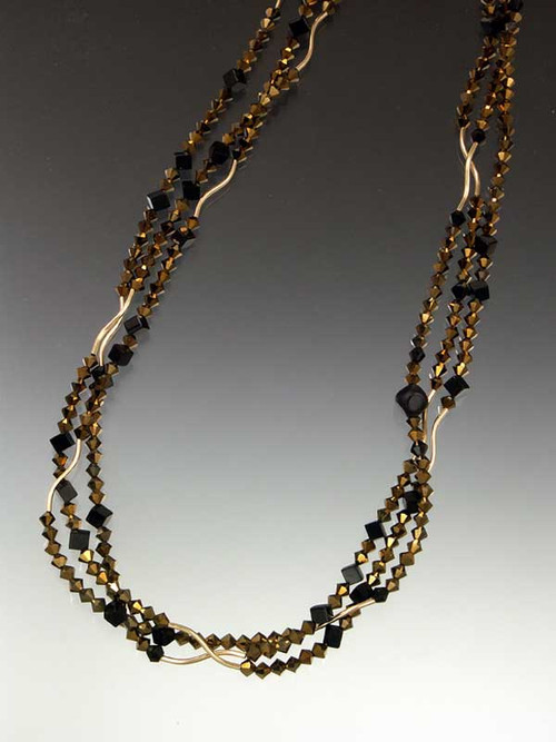 "All out Deco Drama! A glittering 64"" strand of 14K curved beads,"