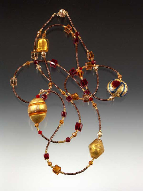 Razzle dazzle them in a rope of brilliant red, gold, and topaz Venetian glass, Swarovski crystals and Japanese seed beads.