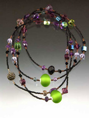 A perfect flapper rope in purples and greens that are fresh this season. This dazzling rope features vintage out of production Swarovski crystals, amethyst rondels, custom Venetian glass beads specially ordered from Venice, and lots of sparkle. A custom marcasite or white topaz clasp lets you wear this as a long flapper rope, double or even triple. 48""