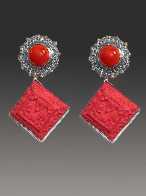 """RETAIL PRICE: $398..... SALE $148 These Amy Kahn Russell earrings are perfect for right now and add glamour and interest with a two stone dangle.  The top features a red coral cabochon with an elaborate silver frame and the bottom features a hand-carved cinnebar dangle. These earrings that will go with everything.   2"""" x  2""""   Now  clips; can be converted to posts for an additional $15."""