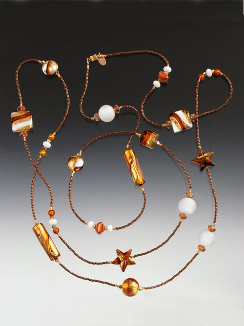 """A whimsical medley of 24K topaz/gold Venetian glass featuring stars, tubes, and special custom designed """"Missoni"""" highlights named for the trademark Missoni stripes. 14K clasp. Choose 44""""or 64"""""""