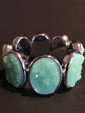"""Make a dramatic statement with a large apple green druzy stretch bracelet set in stainless steel.  Affordable and impressive.  Stretches to 8"""""""