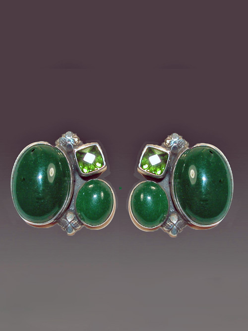 "Love this medley of greens and dramatic design. These Amy Kahn Russell earrings feature two bright green agate and a faceted peridot cabochon in a harmonious composition set in sterling silver. Perfect for any occasion. Aprox 1"" x 3/4"" Now clips; convert to posts for additional $15"